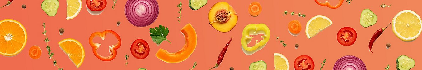 fruits and veggies on salmon color background