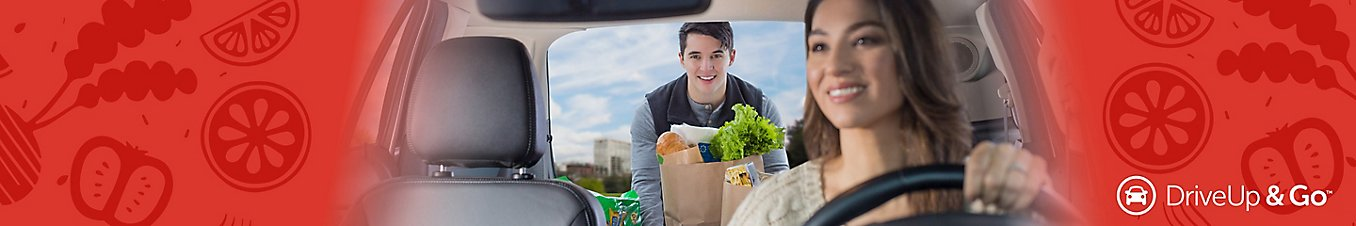 man putting groceries in woman's car