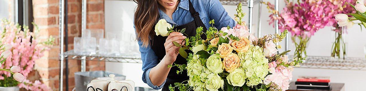 florist arranging bouquet of mixed flowers