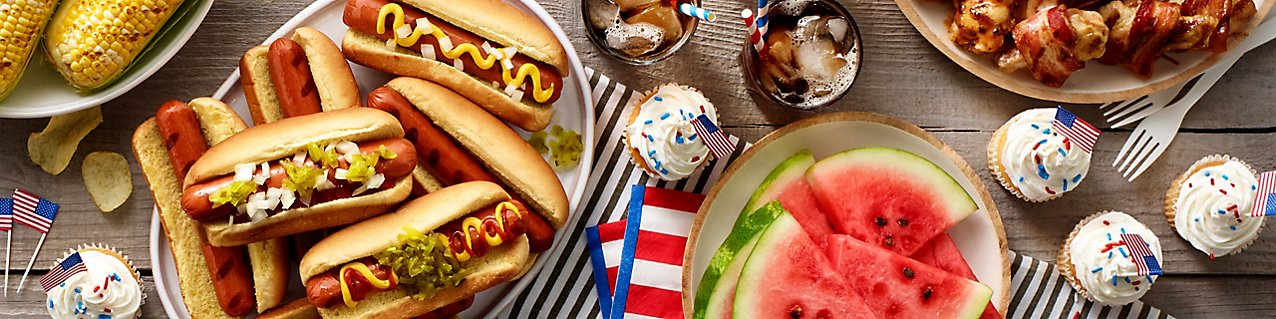 Grill up some hot dogs and corn, and end on a sweet note with tasty cupcakes and watermelon.