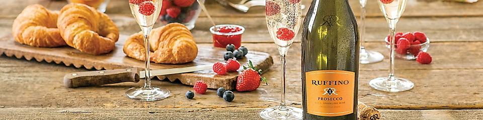 croissants, berries and Ruffino