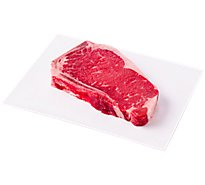 Meat Counter Beef USDA Choice Steak Top Loin New York Strip Bone In Service Case 1 Count - 1.00 LB