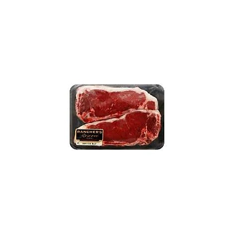 Meat Counter Beef USDA Choice Top Loin New York Strip Steak Bone In Marinated Service Case - 1 LB