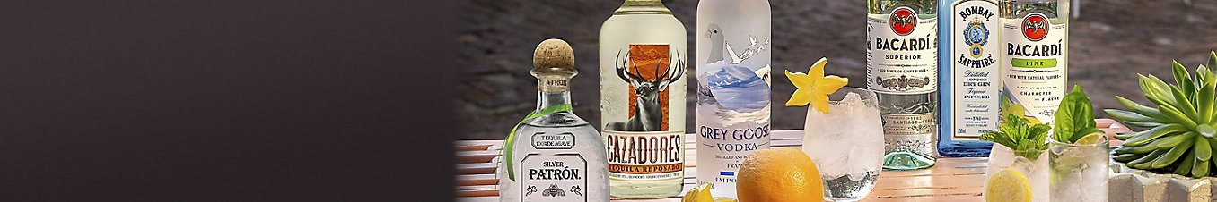 Bottles of Patron, Cazadores, Grey Goose, Bacardi, and Bombay Sapphire