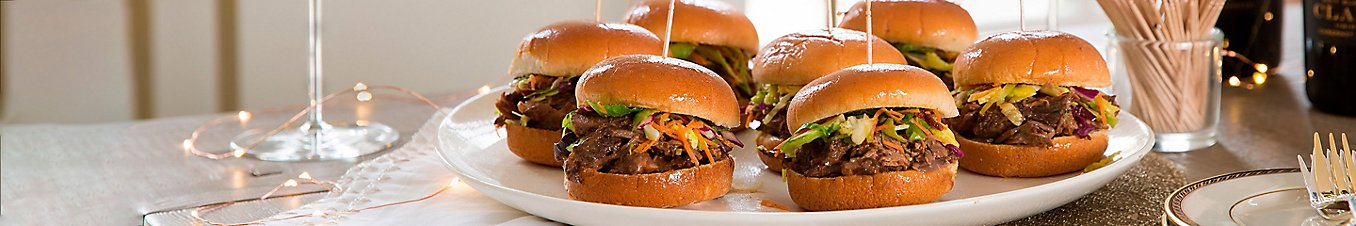 A plate of beef short rib sliders