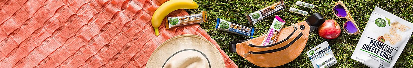 Open Nature® products laid out on the grass