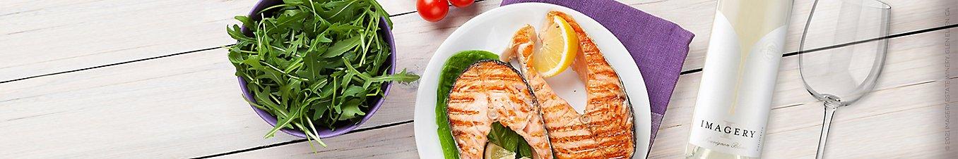 Pan Seared Salmon With Lemony Olive Tomato Sauce and Imagery Sauvignon Blanc